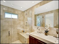 bathroom renovation with glass shower stall